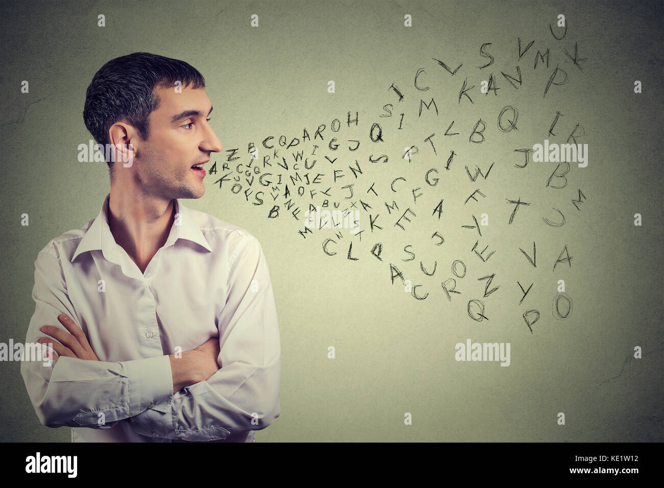 Side profile man talking with alphabet letters coming out of his mouth. Communication, information, intelligence Stock Photo
