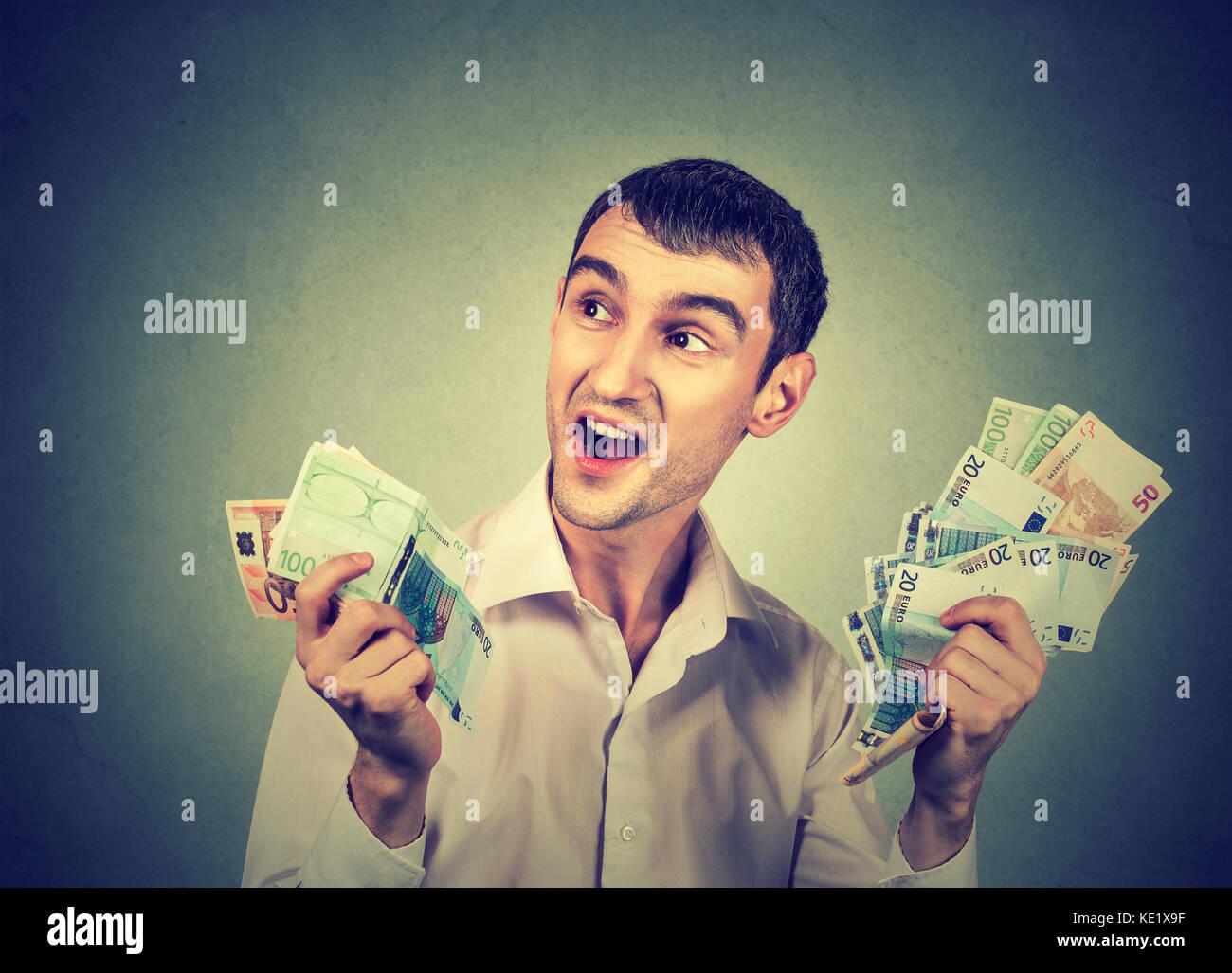 Happy man with money - Stock Image