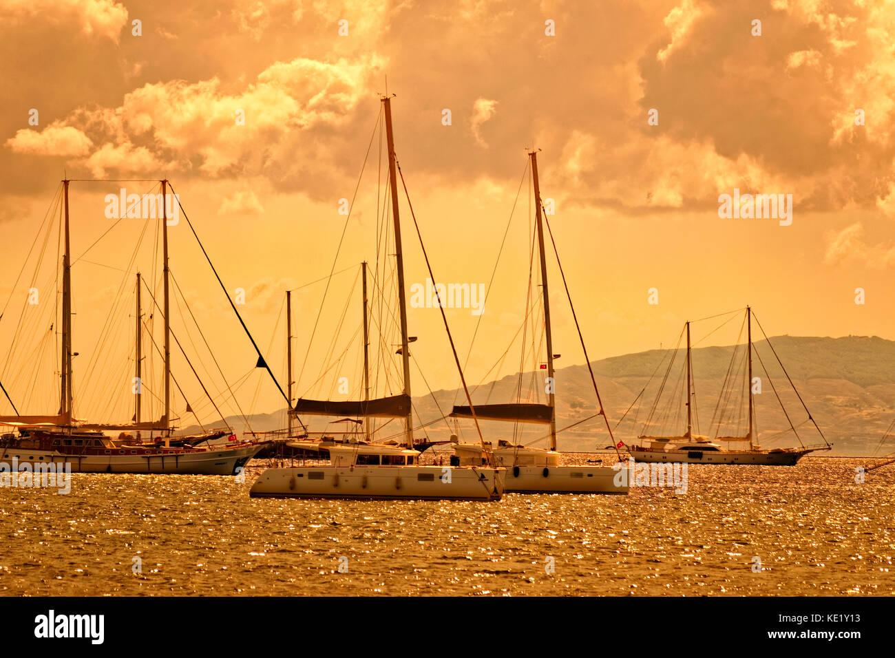 Catamarans and yachts at anchor, Bodrum, Turkey. - Stock Image