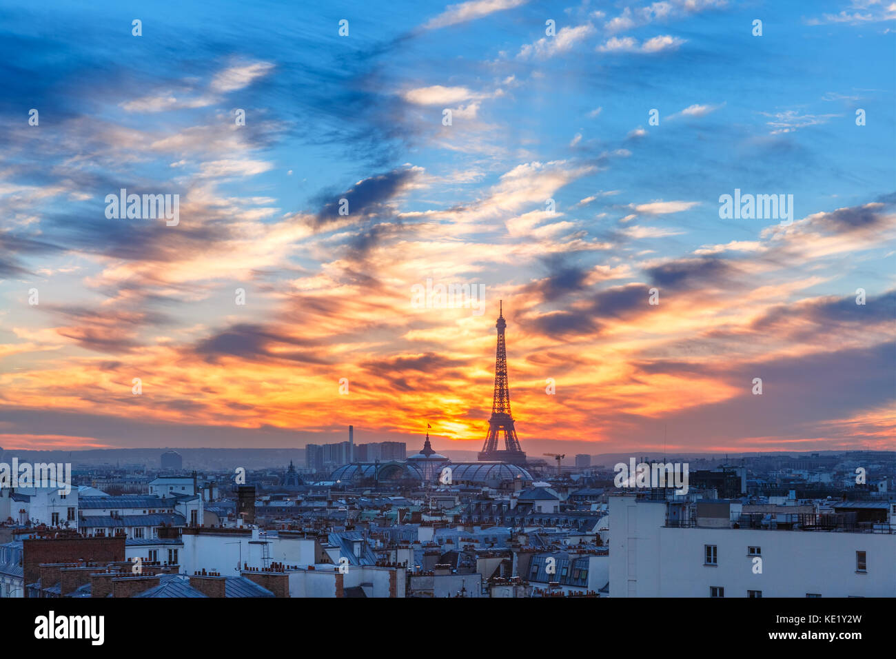 Eiffel Tower at sunset in Paris, France - Stock Image