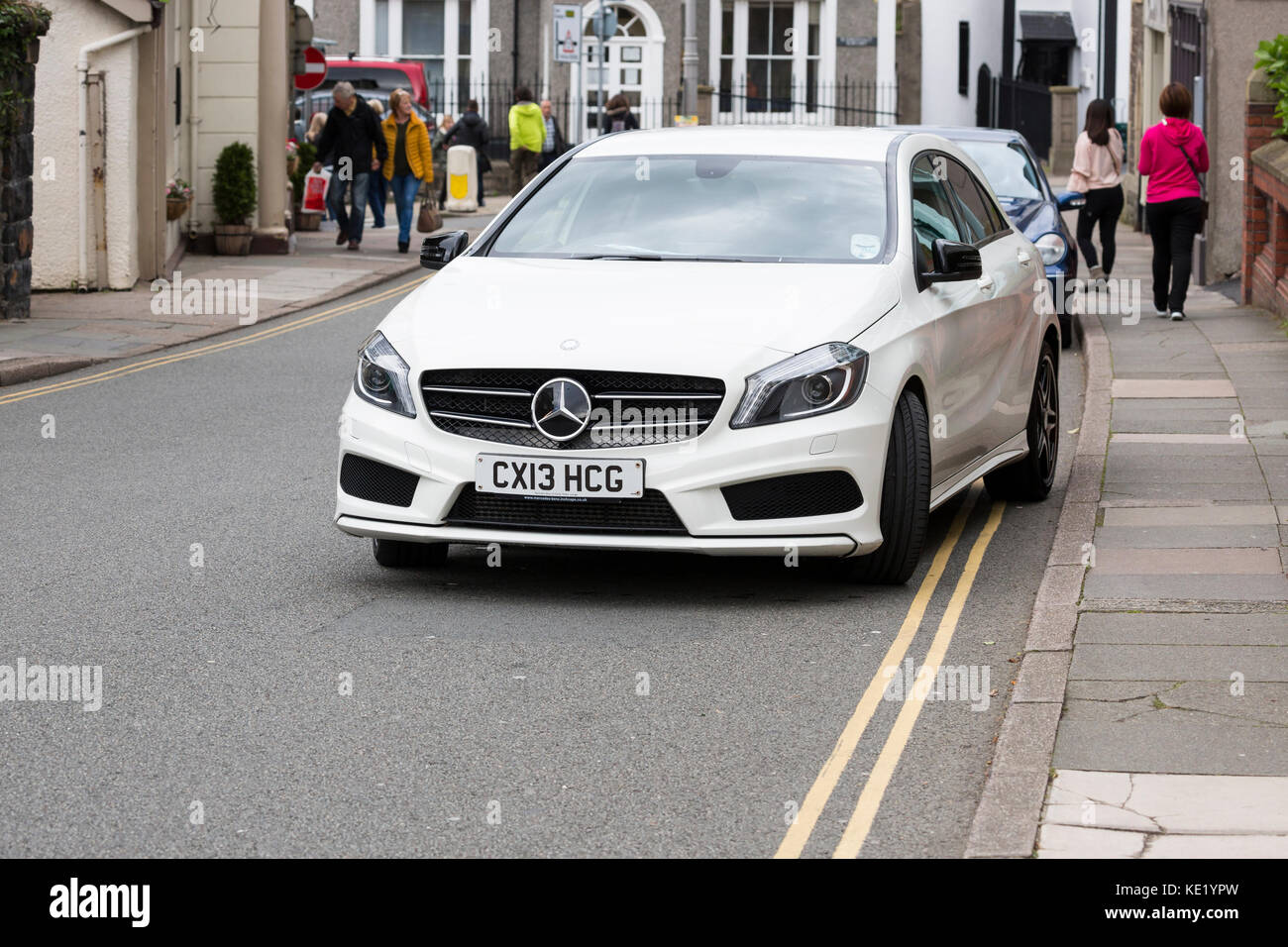 badly parked car on double yellow lines - Stock Image