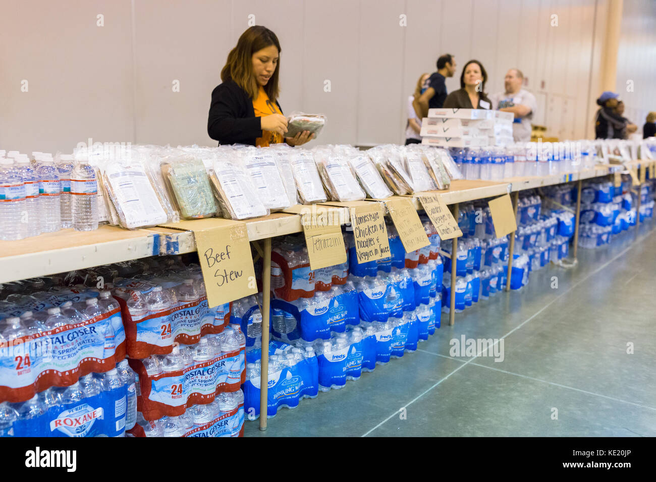 Torrential rain from Hurricane Harvey has caused record flooding in Houston. Emergency shelter is stocked with supplies - Stock Image