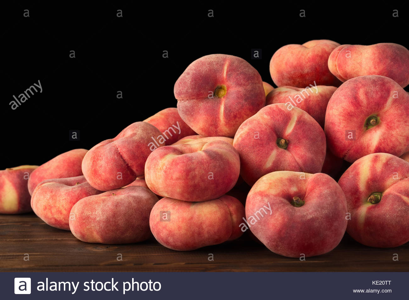 Sweet, Saturn peaches, a fruit rich in vitamins and minerals, in season in spring and summer, are also known as - Stock Image