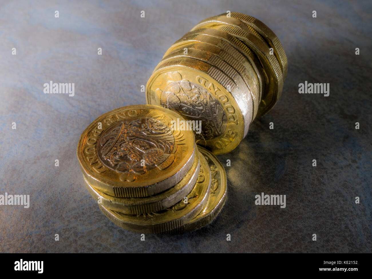 New 12 sided sterling pound coins against a subtle background. Can be used to illustrate any aspect of new pounds - Stock Image