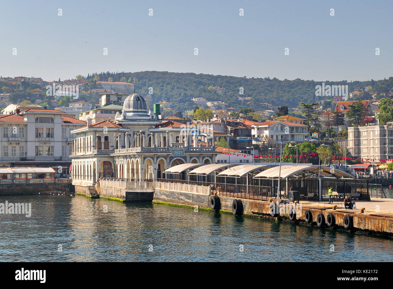 Istanbul, Turkey - April 27, 2017: Buyukada (Princess Island) Ferry Terminal with passengers riding a ferry and - Stock Photo