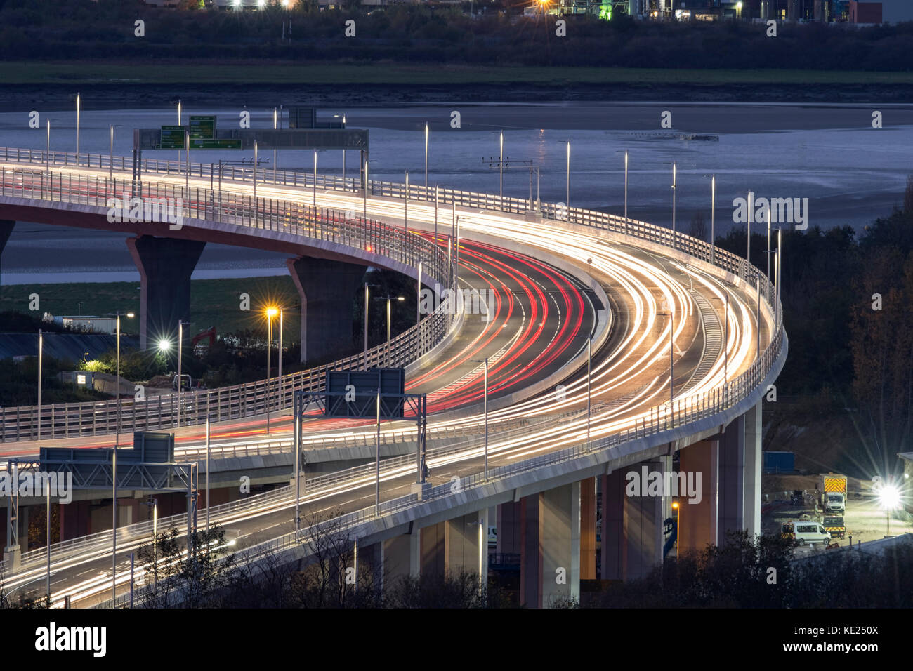 Runcorn Entry and Exit Ramp of the Mersey Gateway Bridge over the Mersey Estuary at night, Runcorn, Cheshire, England, - Stock Image