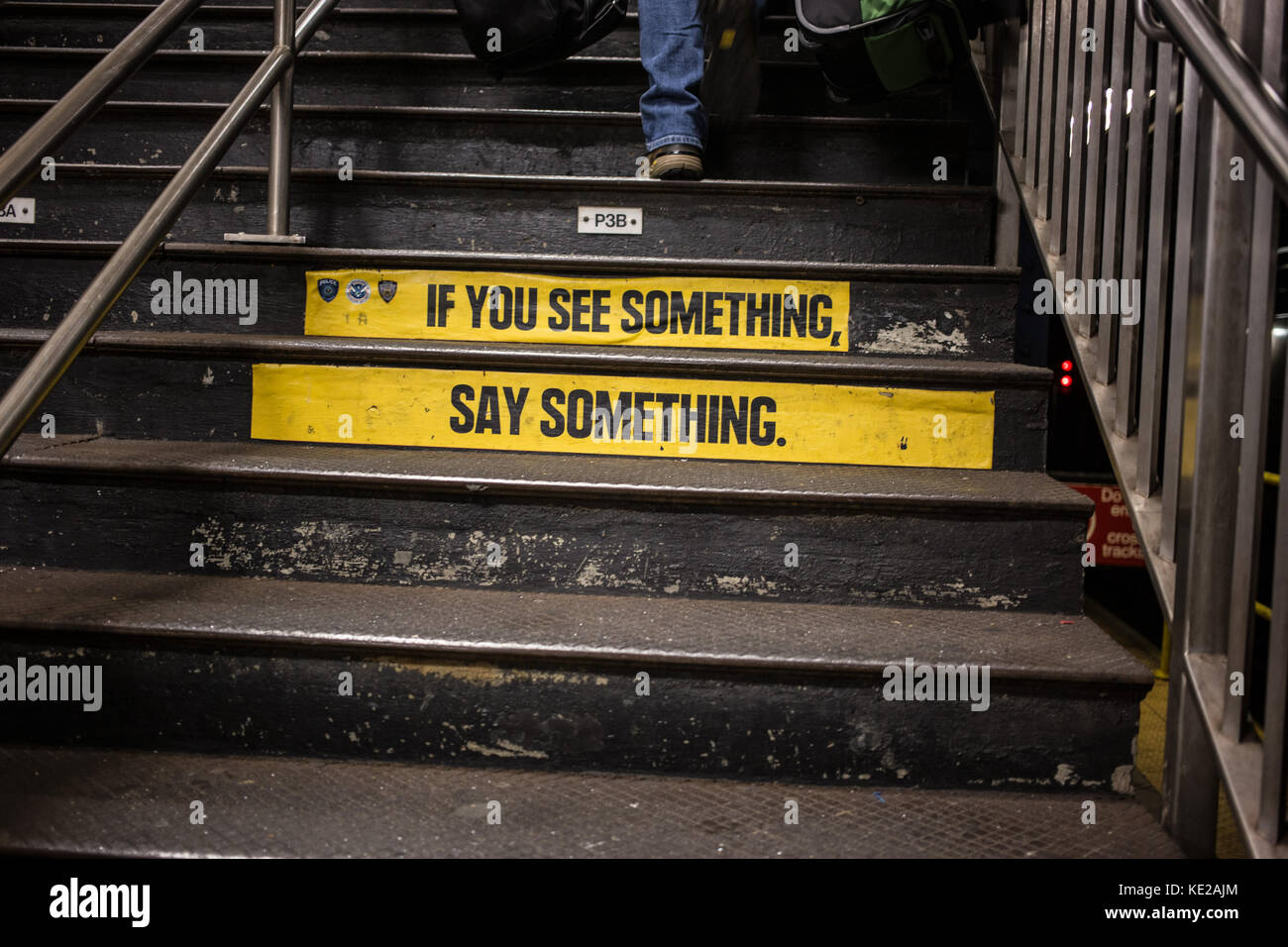 'If You See Something, Say Something' advertisement on stairs in subway station in Manhattan, NY. - Stock Image
