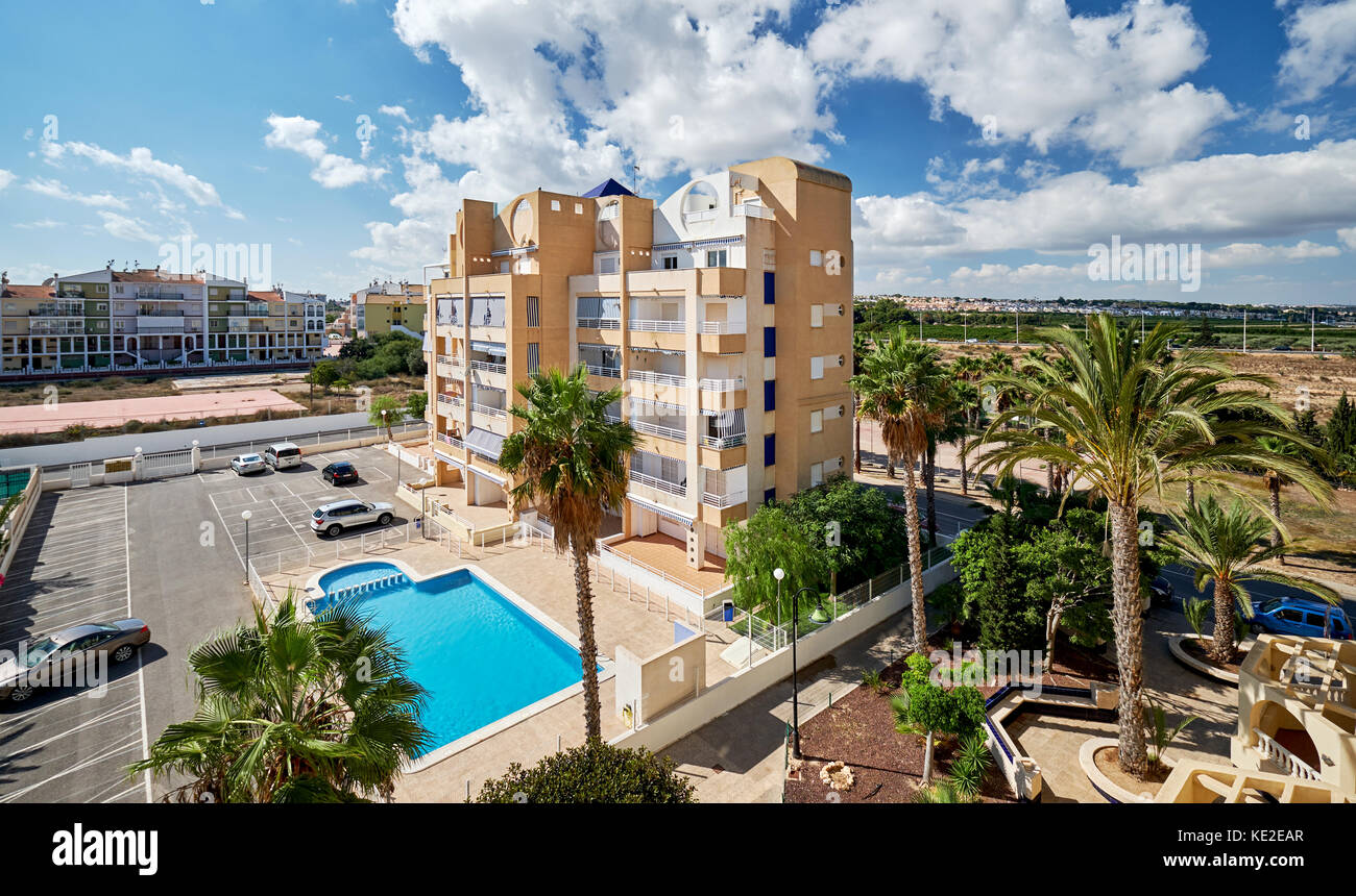 Torrevieja, Spain - October 16, 2017: View to the typical spanish urbanisation with swimming pool in the Torrevieja - Stock Image
