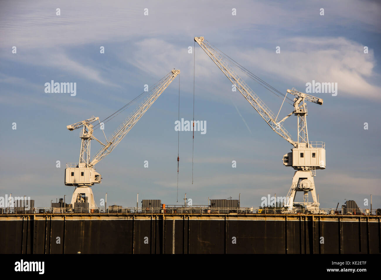 The dry dock for reconstruction of the ships and cranes above ready to work Stock Photo