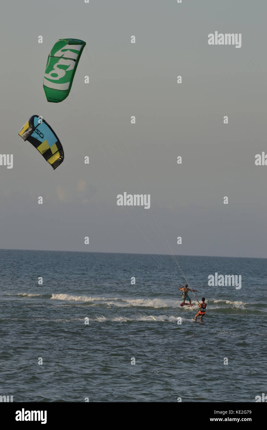 Kitesurfers in the sea in front of Kunduchi Beach Hotel north of Dar es Salem Tanzania - Stock Image