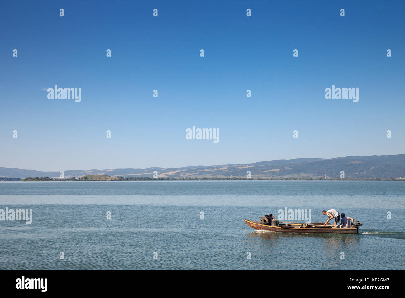 DONJI MILANOVAC, SERBIA - SEPTEMBER 16, 2017: Fishermen fishing on a boat near Donji Milanovac during the afternoon, - Stock Image