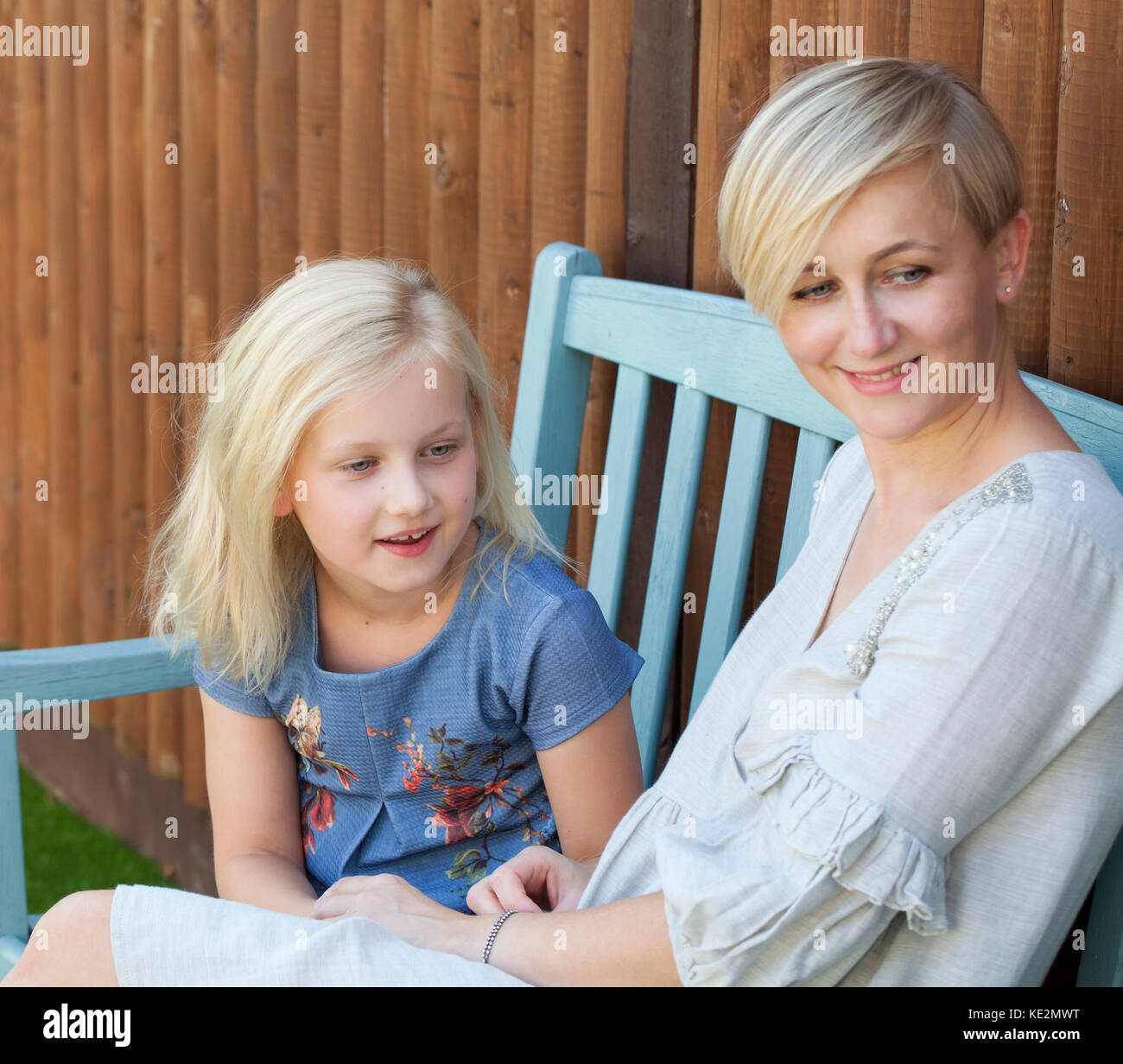 Mum with her young daughter in the garden - Stock Image