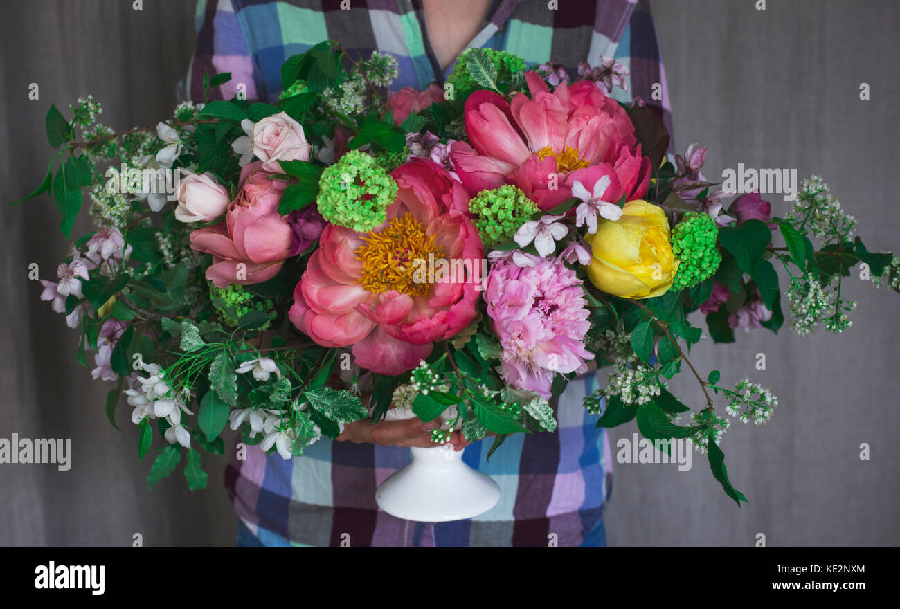 Florist holding large bouquet of flowers in rustic style Stock Photo ...