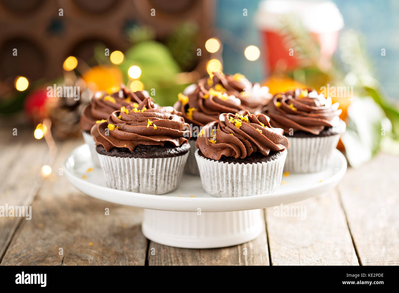 Chocolate orange cupcakes for Christmas with ganache frosting - Stock Image