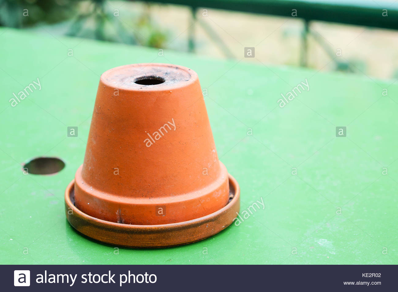 Alamy & Upside down flower pot as a ash tray Stock Photo: 163560434 - Alamy
