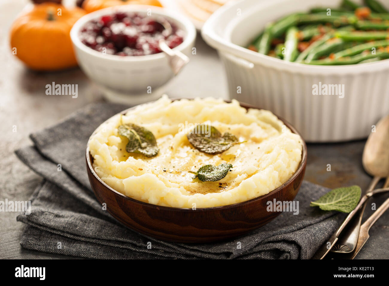 Mashed potatoes with butter and sage, side dish for Thanksgiving or Christmas dinner - Stock Image