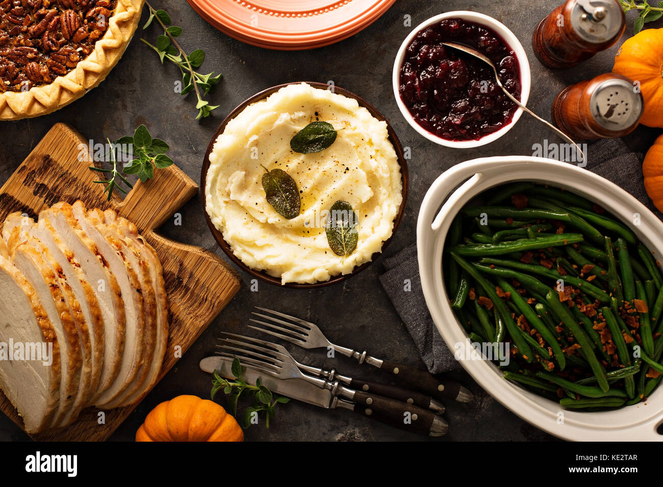 Mashed potatoes with butter and sage, side dish for Thanksgiving or Christmas dinner overhead shot - Stock Image