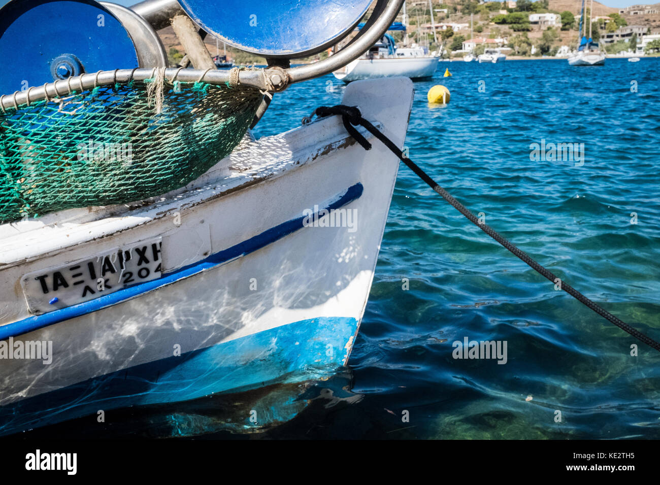 Old wooden fishing boat anchored in port - Stock Image