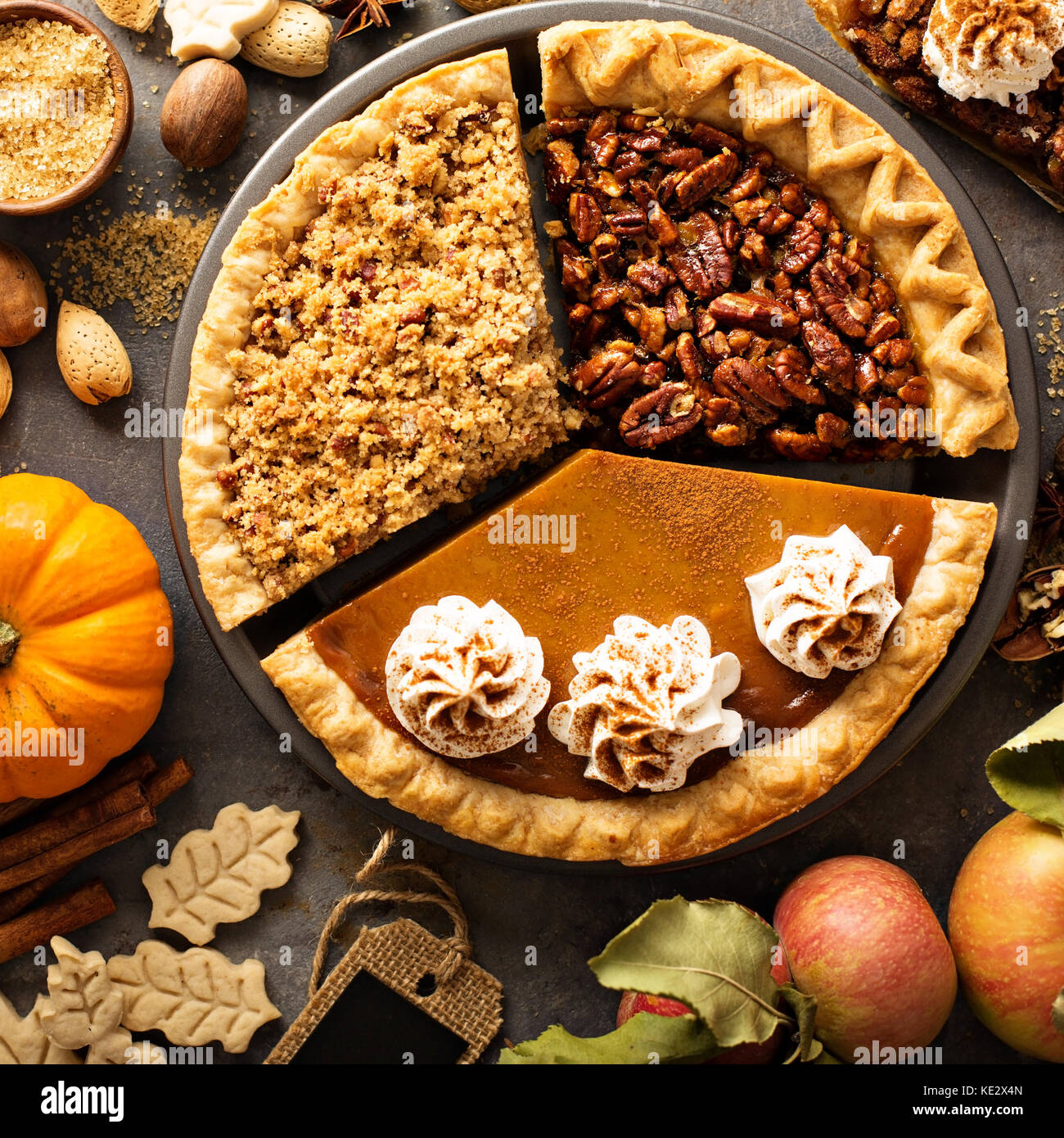 Fall traditional pies pumpkin, pecan and apple crumble - Stock Image