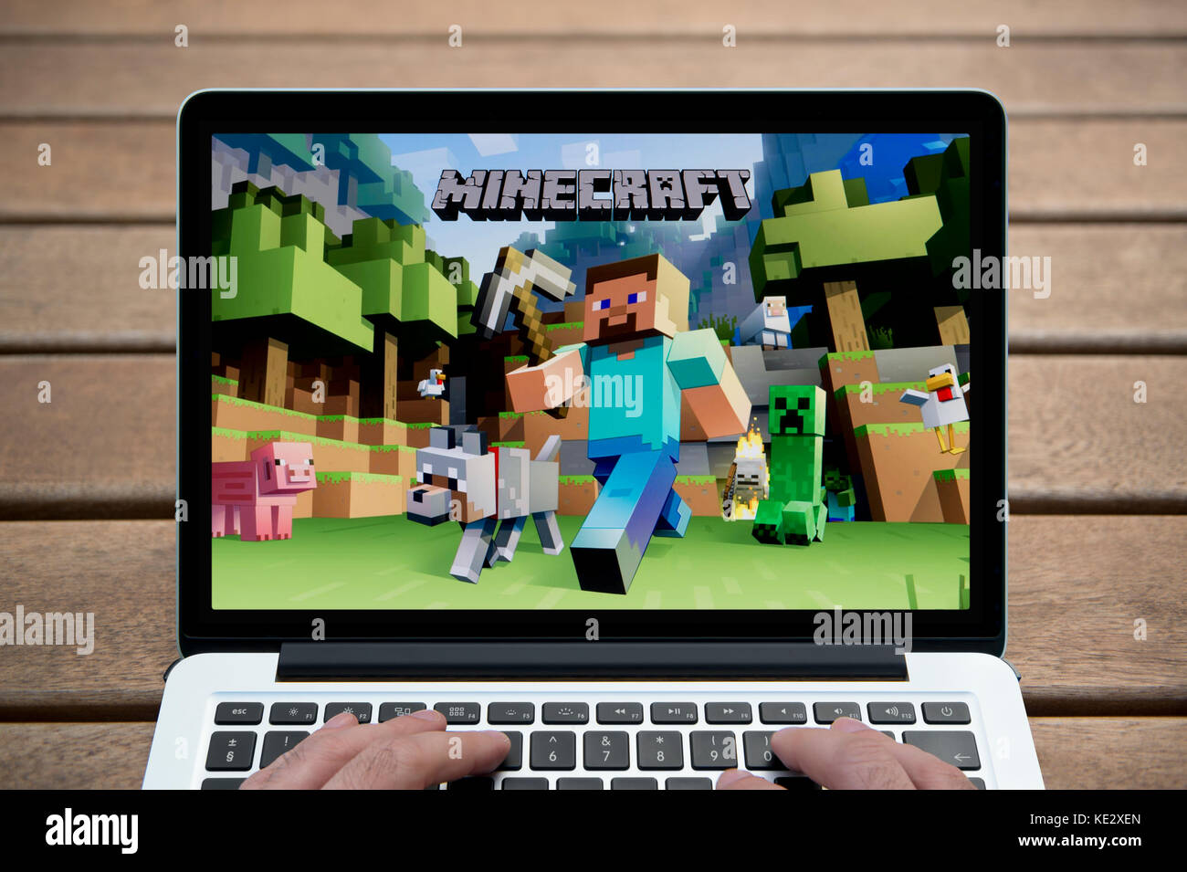 Minecraft screen stock photos minecraft screen stock images alamy the minecraft game on the screen of a macbook pro laptop shot against a wooden ccuart Gallery