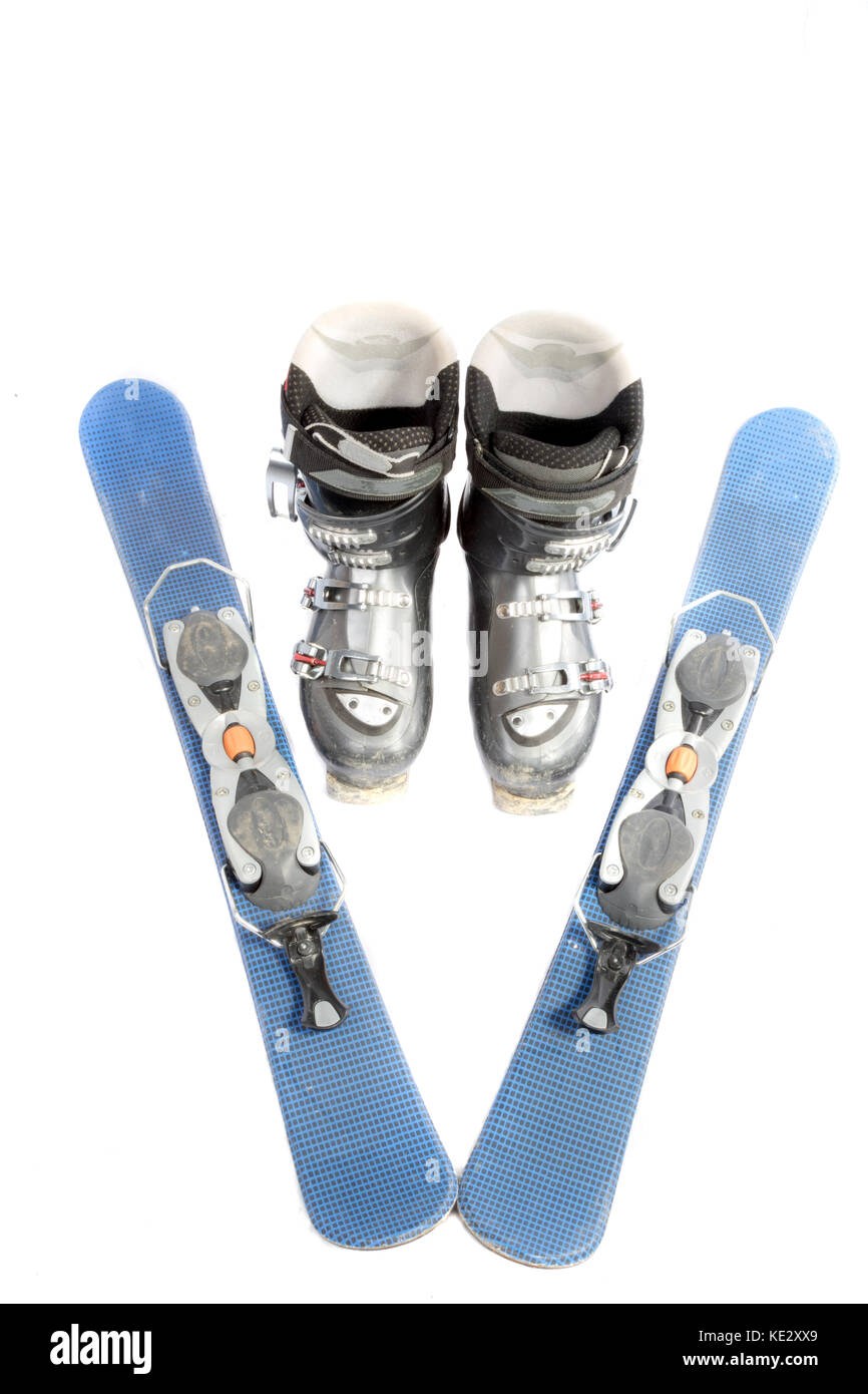 Ski boots and blades isolated on a white background - Stock Image
