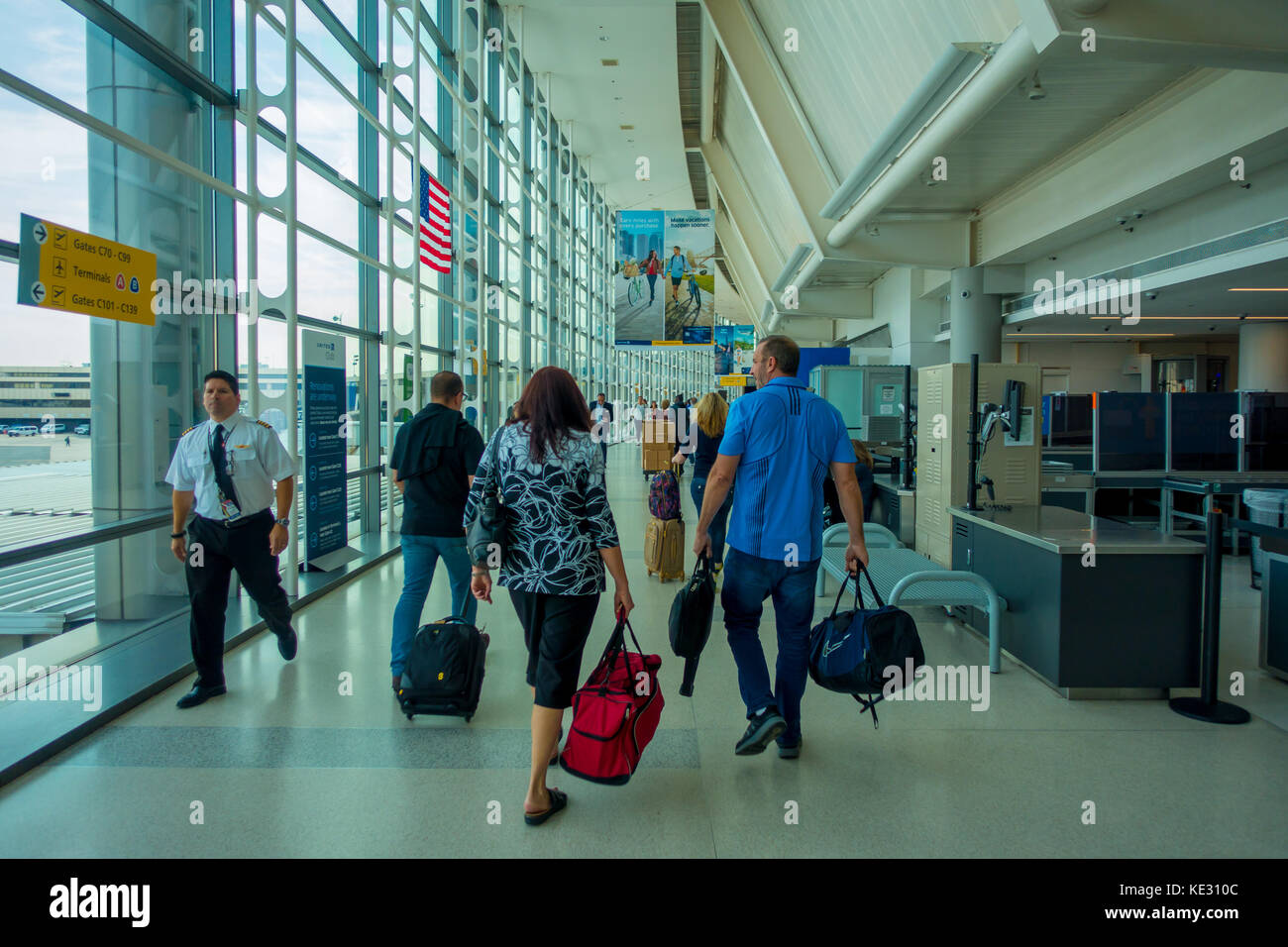 NEWARK, NJ - OCTOBER 16, 2017: Unidentified people walking at Newark Airport interior in Newark, New Jersey. Newark - Stock Image