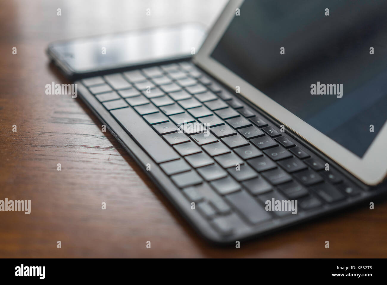 Home office with Gadgets - Tablet and Cell Phone - Stock Image