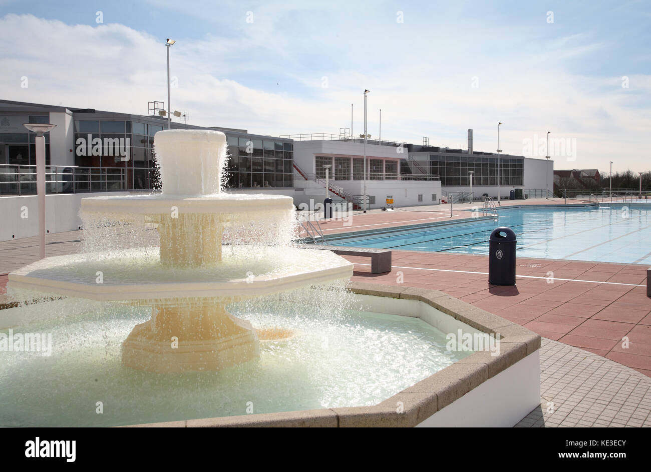 Fountain at the newly refurbished outdoor swimming pool at Uxbridge Lido and sports centre west of London, UK. - Stock Image