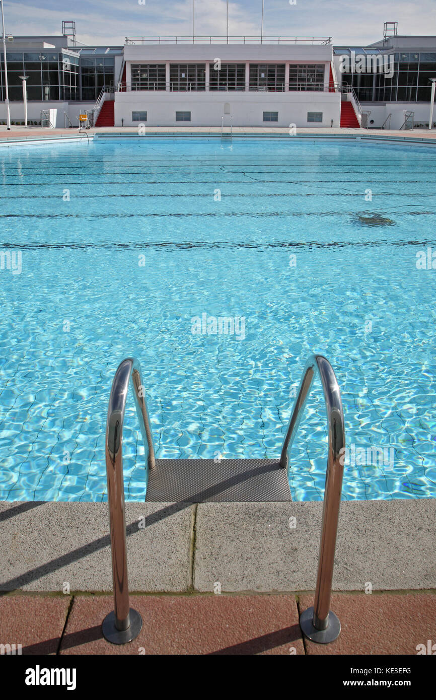 Pool ladder at the newly refurbished outdoor swimming pool at Uxbridge Lido and sports centre west of London, UK. - Stock Image