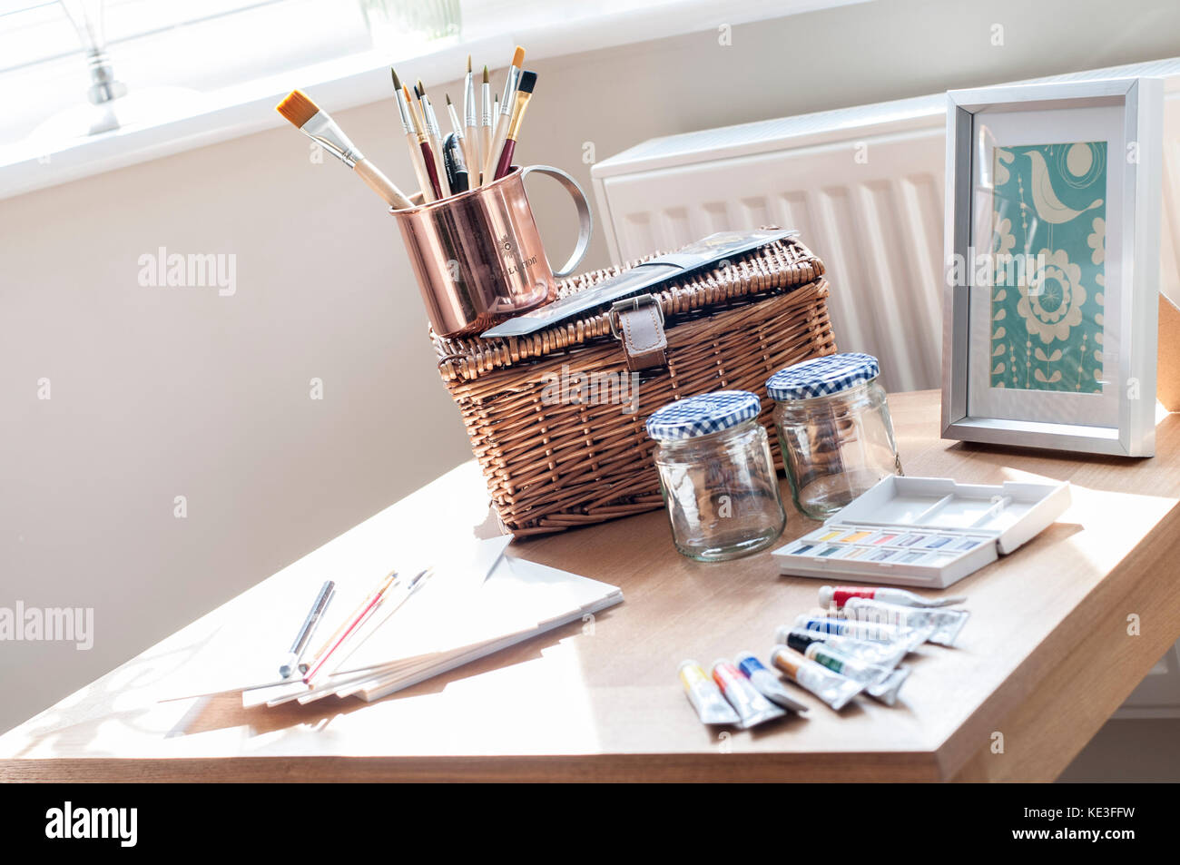 small crafting table in living space - Stock Image