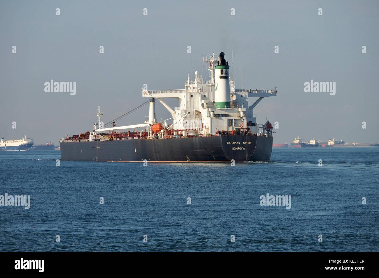 Liberia flagged Crude Oil Tanker, Bahamas Spirit Monrovia, cruising through Singapore Straits - Stock Image