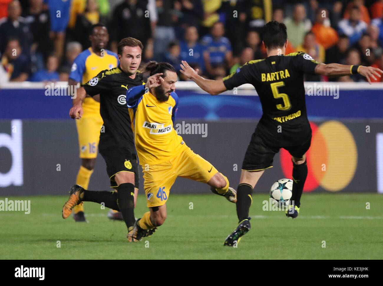 Nicosia, Cyprus. 17th Oct, 2017. Apoel's Stathis Aloneftis (C) vies for the ball during the 2017-2018 Champions Stock Photo