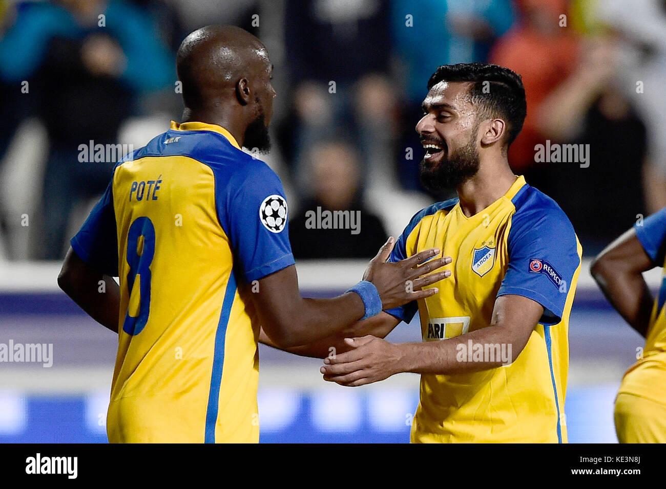 Nicosia, Cyprus. 17th Oct, 2017. Nicosia's Mickael Pote (L) celebrates his 1-0 goal during the Champions League Stock Photo