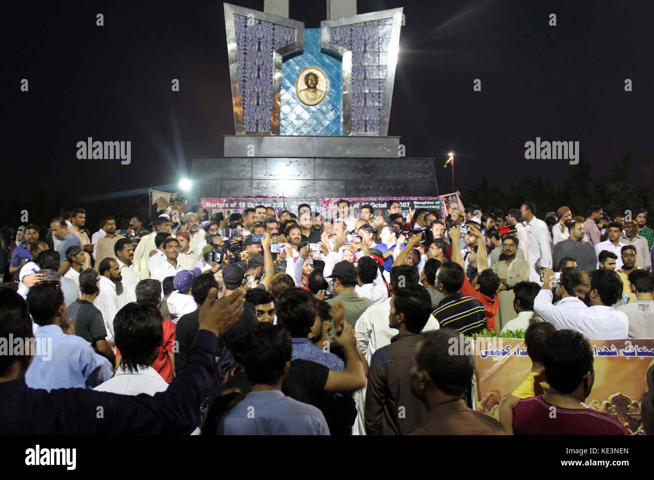 Activists and leaders of Peoples Party gathering at monument on Karsaz Road in reminiscence of political workers - Stock Image