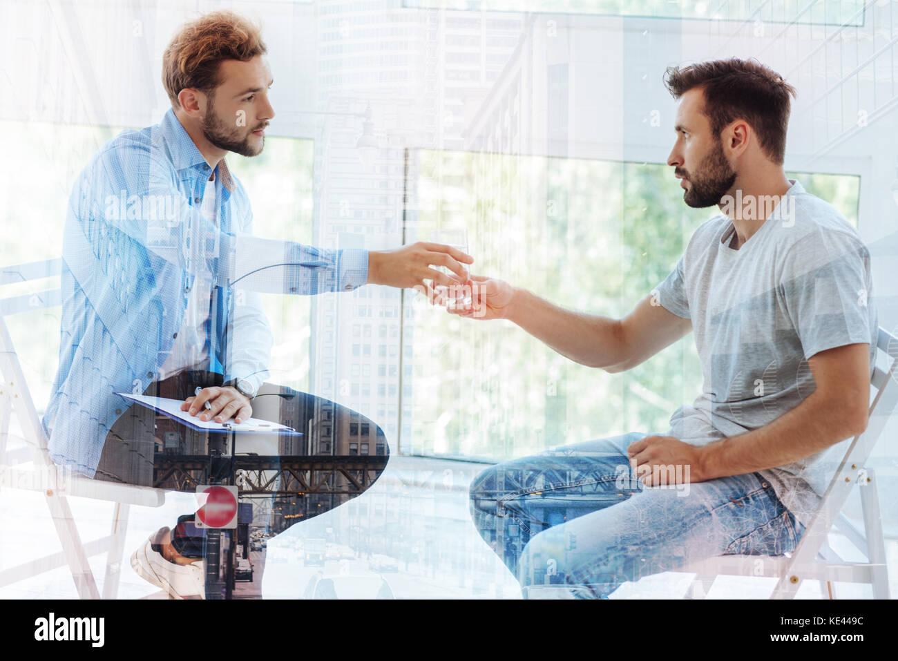 Patient feeling nervous when attending psychiatrist - Stock Image