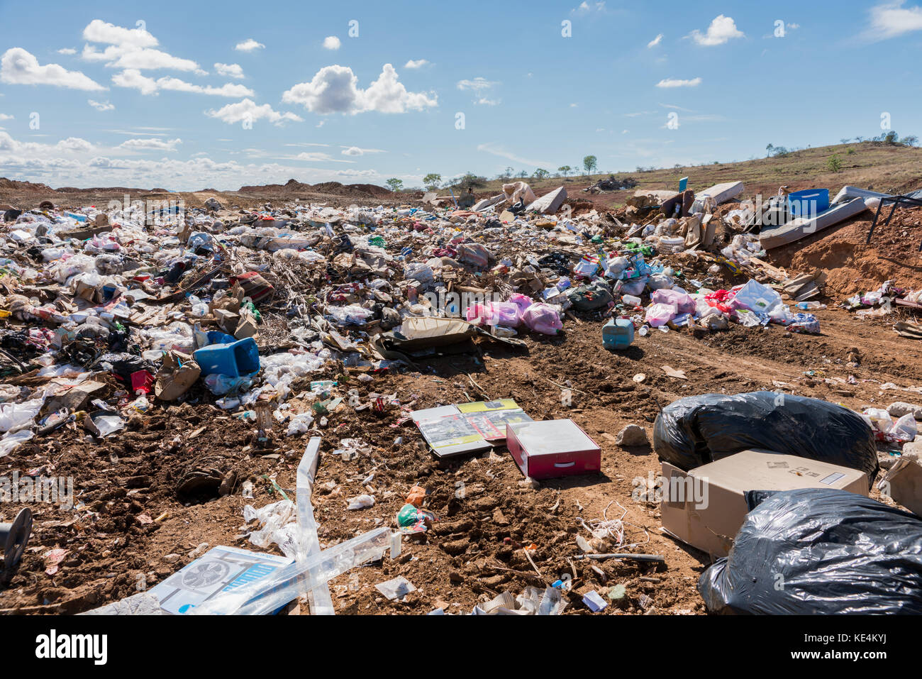 Piles of household refuse in dumping area at local tip - Stock Image