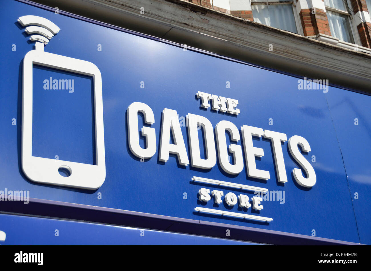 The Gadgets Store shop sign, North Finchley, London, UK. - Stock Image