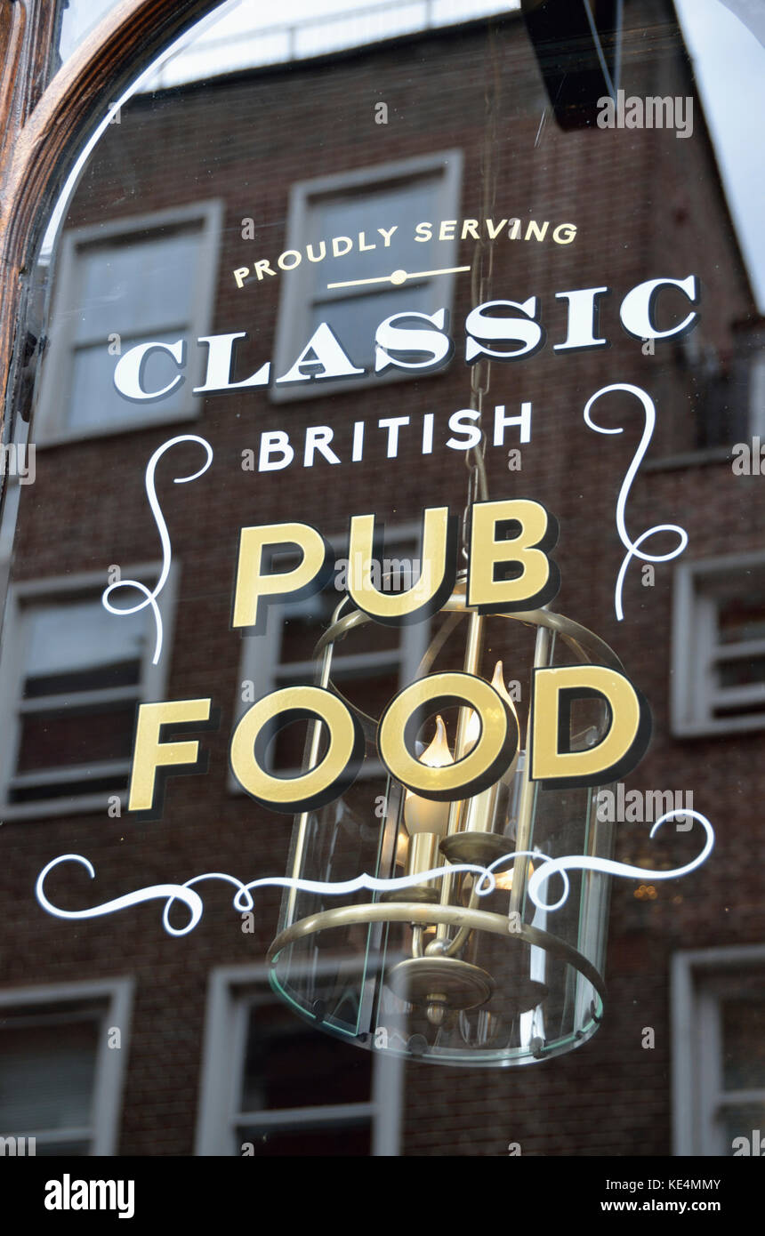 Classic British pub food sign on a pub glass window. - Stock Image