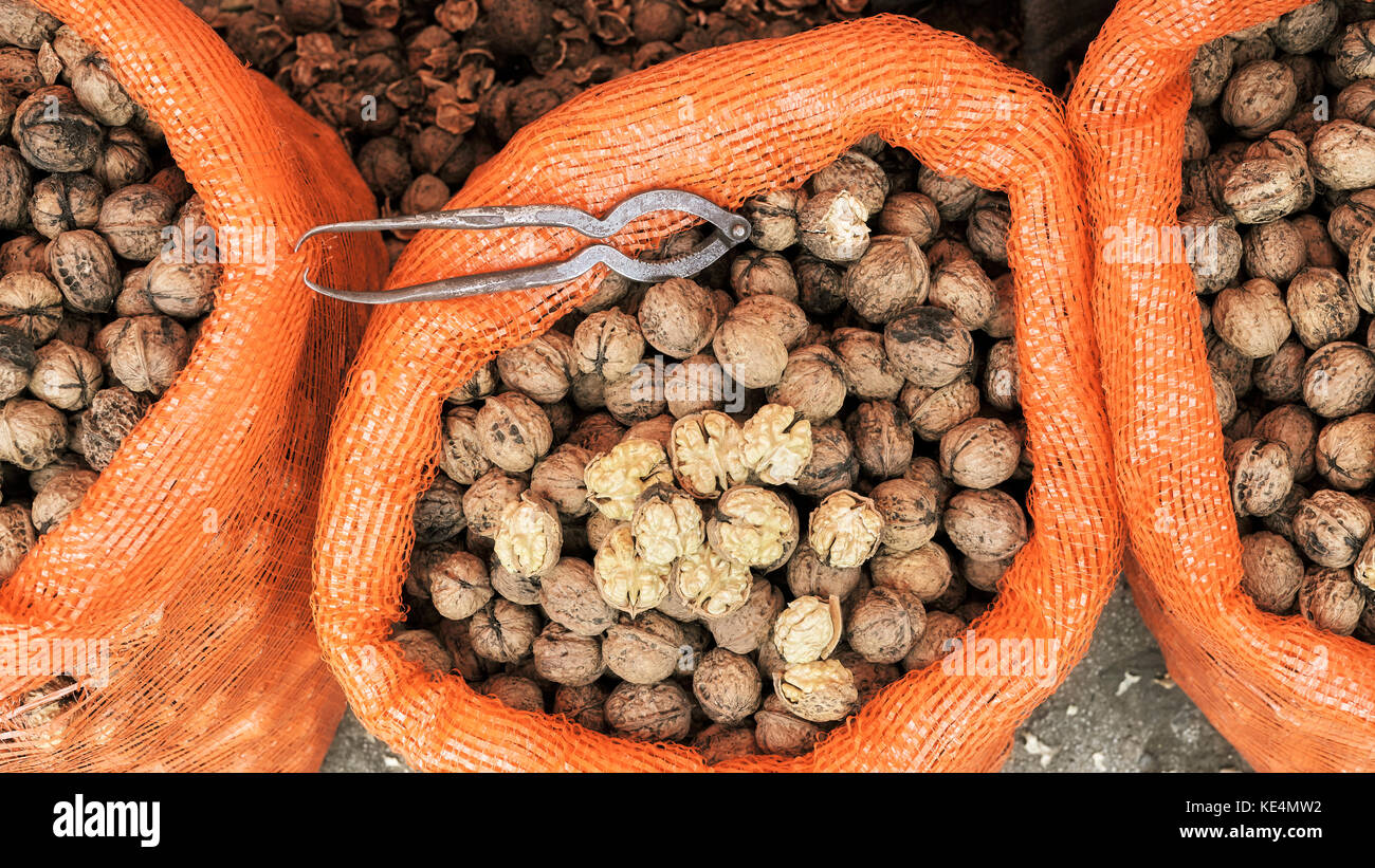 Close up picture of walnuts in a bag on a local market, selective focus. - Stock Image