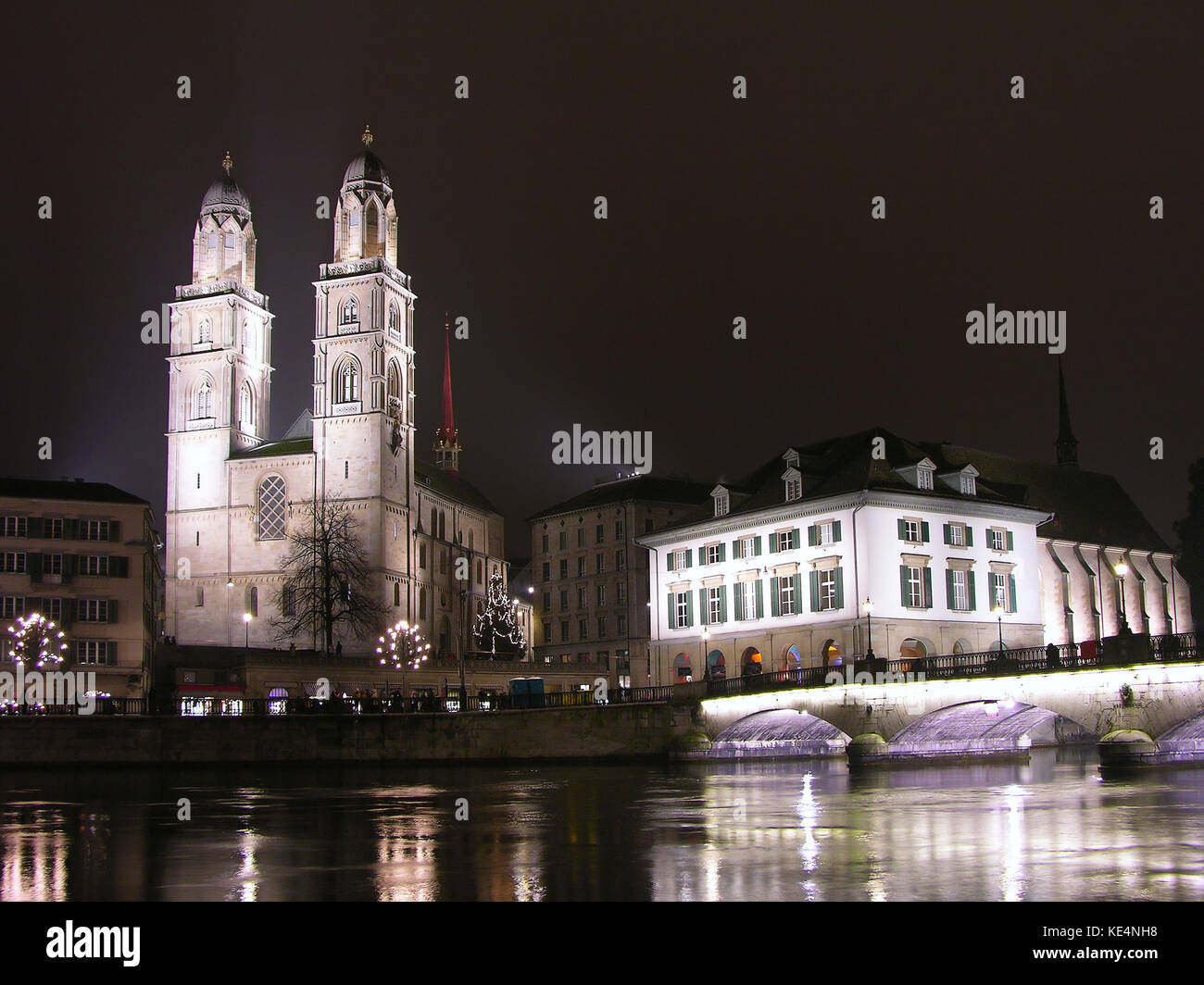 Grossmunster and Limmat river at night, Zurich downtown, Switzerland - Stock Image