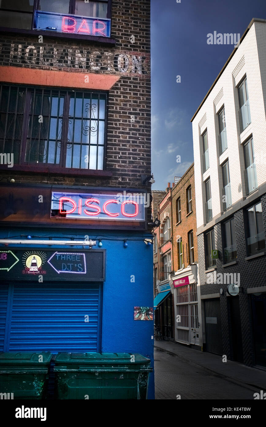 bar disco neon sign daytime street view east london - Stock Image