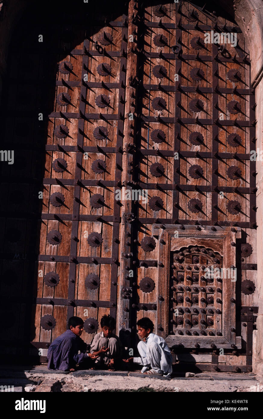 Children playing beside the mighty doors of the Attock Fort built to Stock Photo 163606108 - Alamy & Children playing beside the mighty doors of the Attock Fort built ...