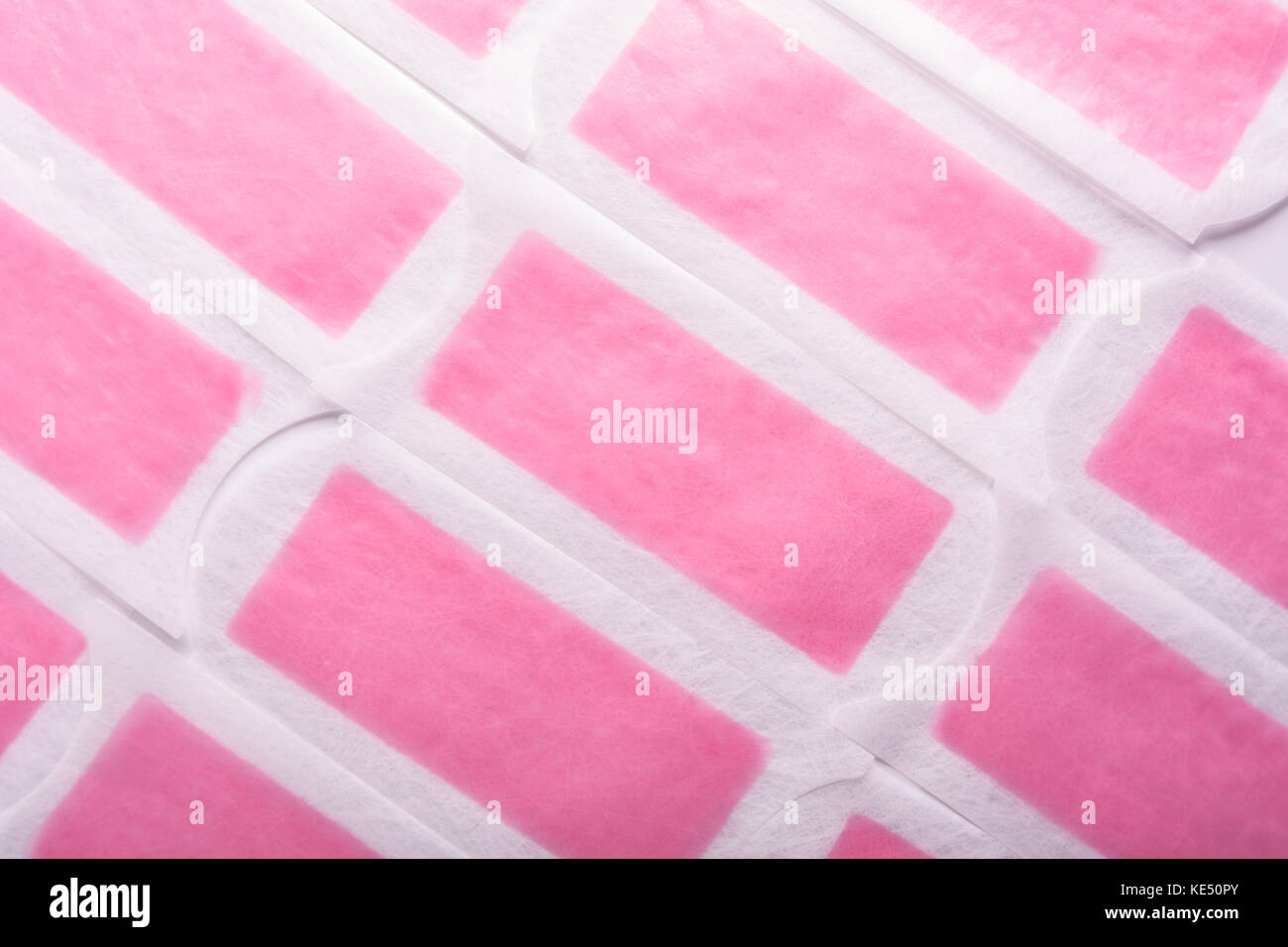 Hair removal wax strip. Depilation body hair background - Stock Image