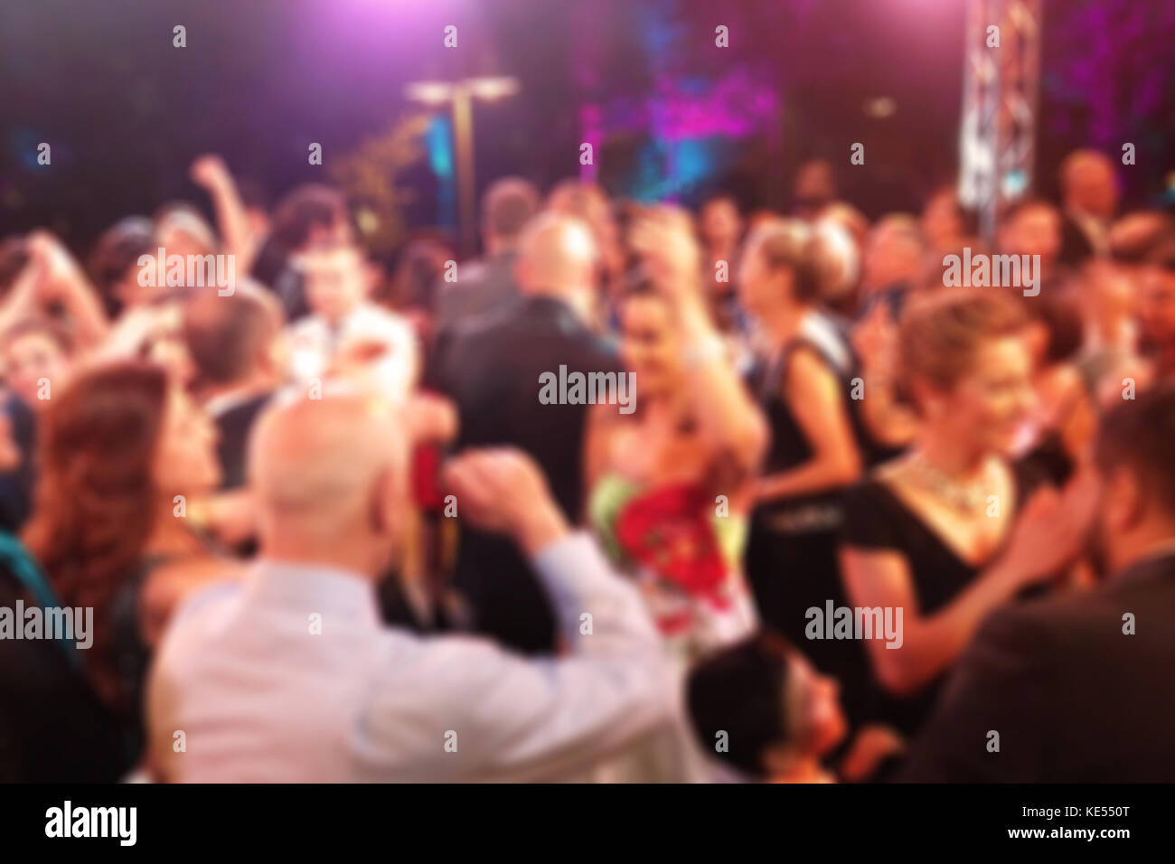 Blurred background with people in a night dancing party - Stock Image