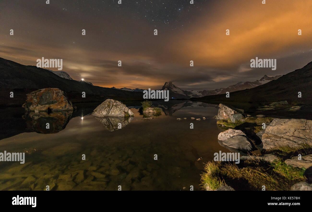 Matterhorn reflected in the Stellisee, night view, Zermatt, Valais Alps, Canton Valais, Switzerland - Stock Image