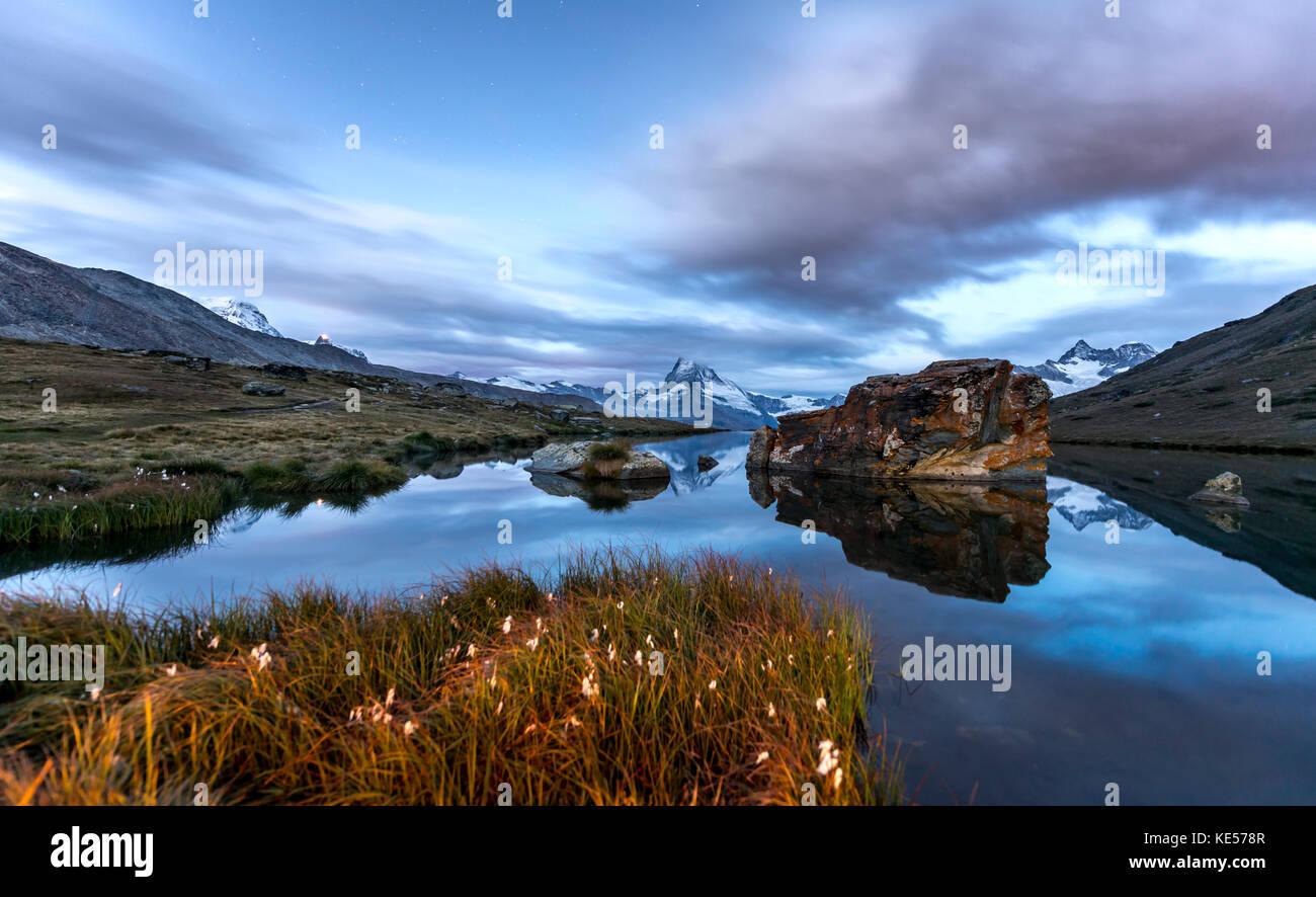 Matterhorn reflected in the Stellisee, Zermatt, Valais Alps, Canton Valais, Switzerland - Stock Image