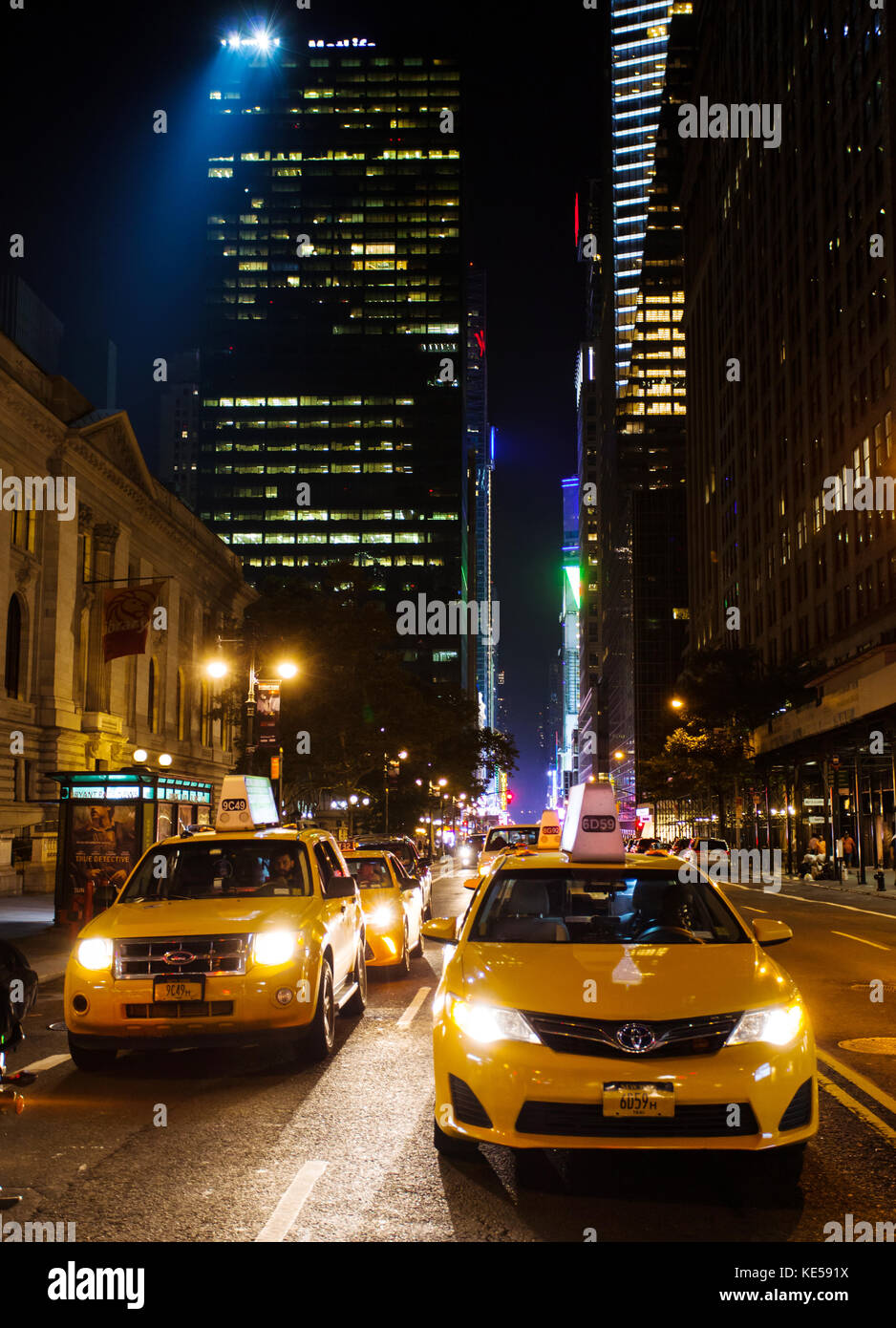 New York City, Usa - July 12, 2015: Traffic with many yellow cabs in downtown Manhattan on 42nd Sreet by night. - Stock Image