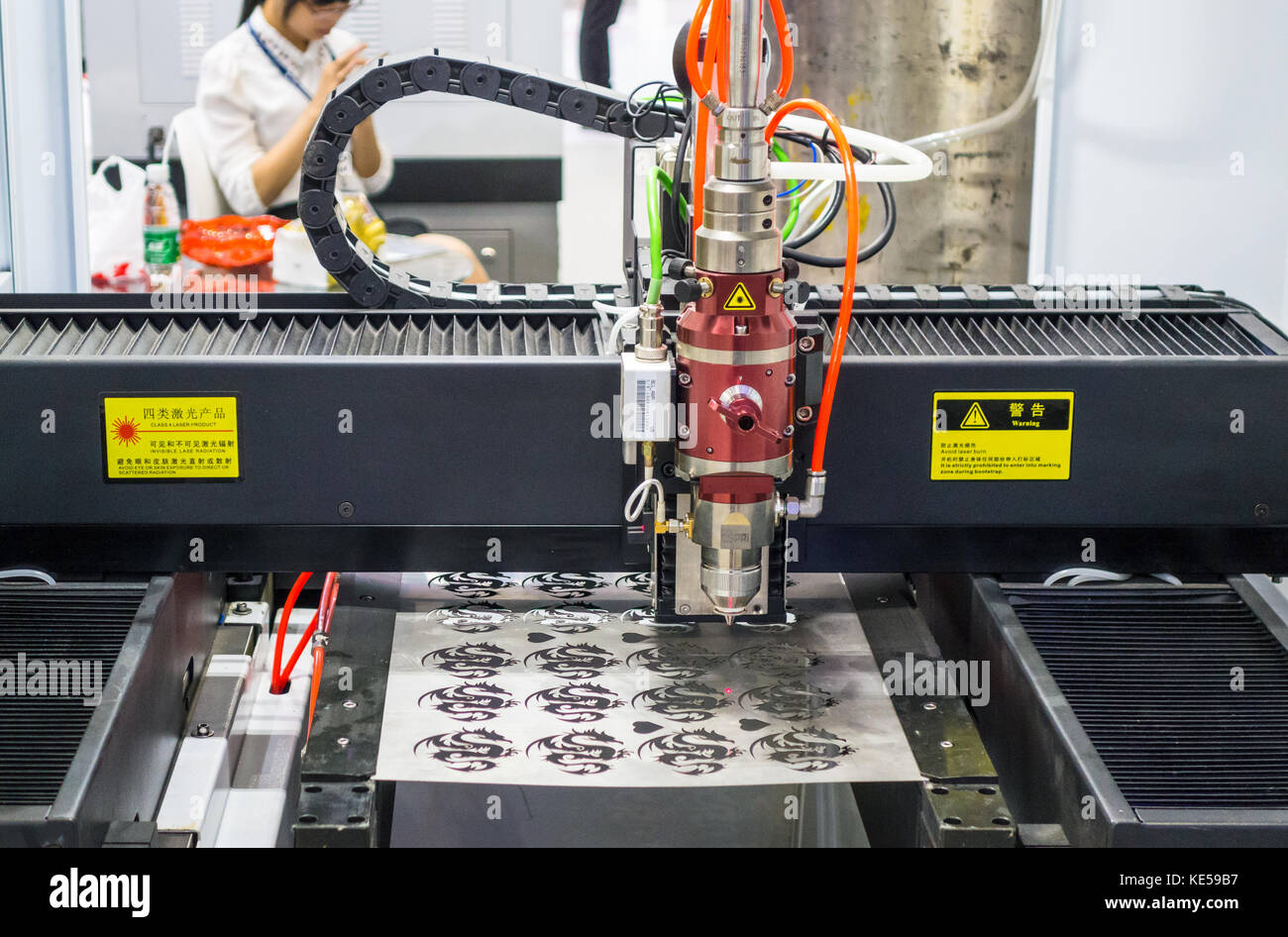 Laser engraving machine demo in Shenzhen, China - Stock Image