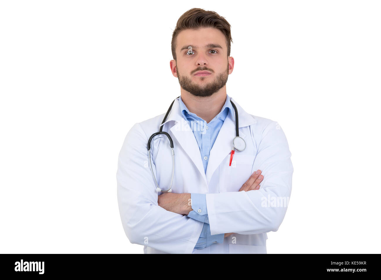 Portrait of confident young medical doctor on white background - Stock Image