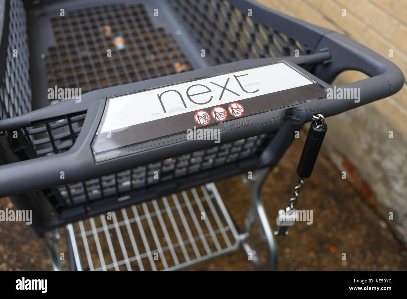Shopping trolley from Next with pound coin lock attachment - Stock Image